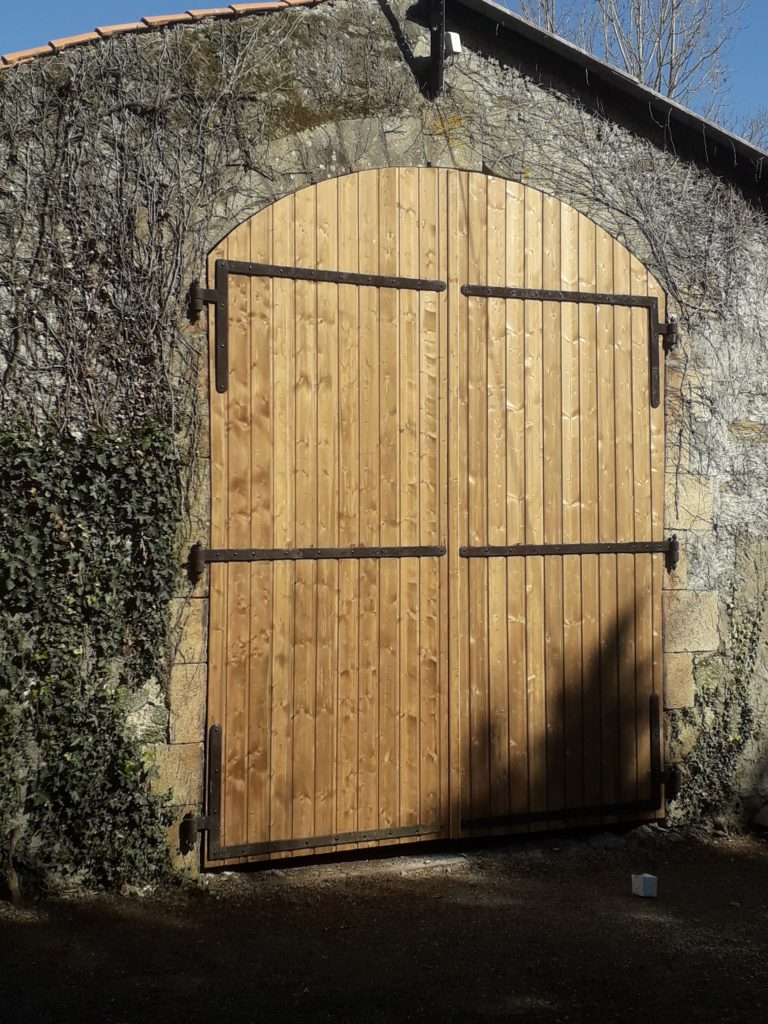 Création en bois : Porte de grange